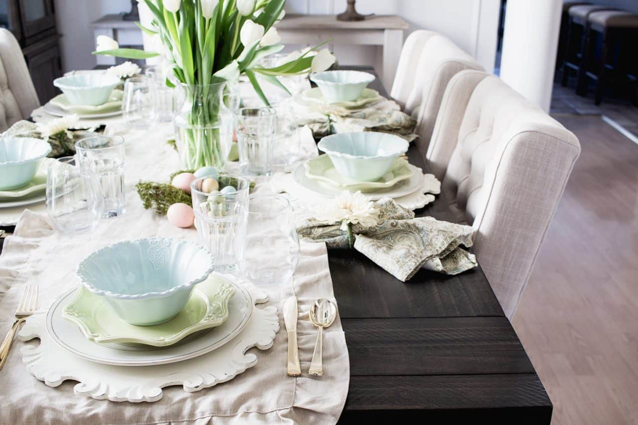 dark table, linen runner, pastel dishes