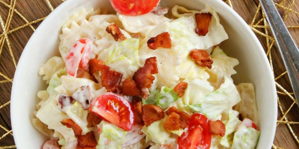 blt pasta salad in bowl with fork beside