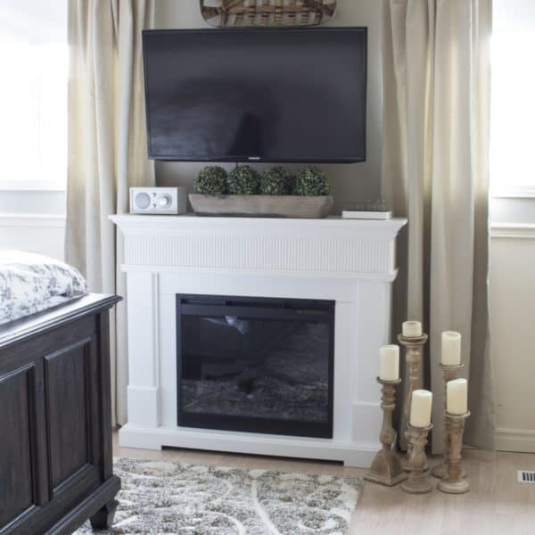 electric fireplace with Olympia Elegant Rug detail, from The Brick