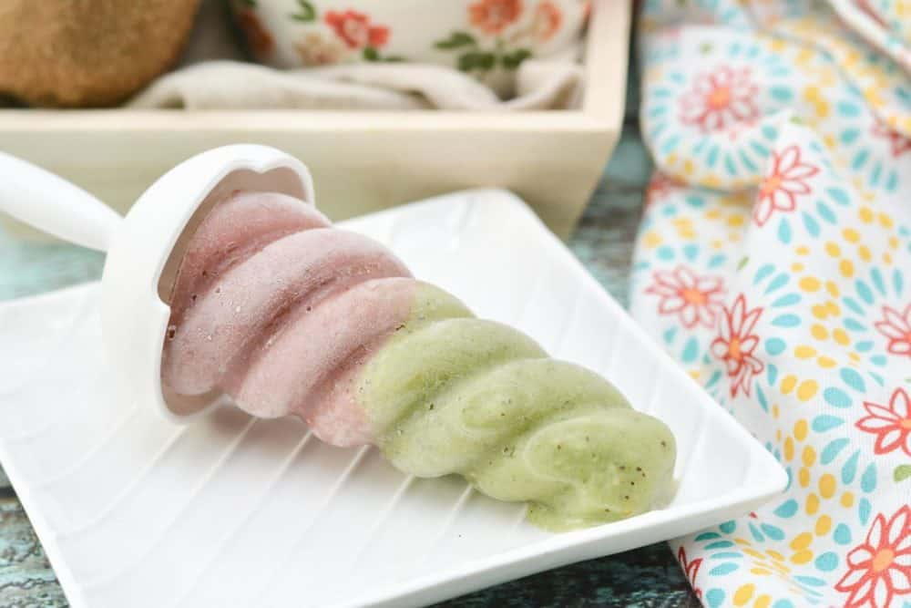 Strawberry kiwi popsicle on a white square plate
