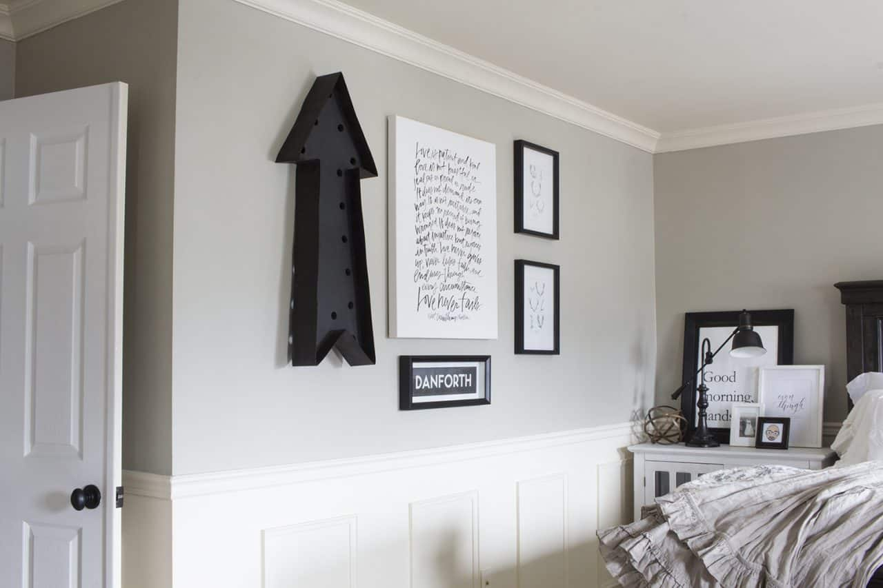 gallery wall in black and white farmhouse bedroom