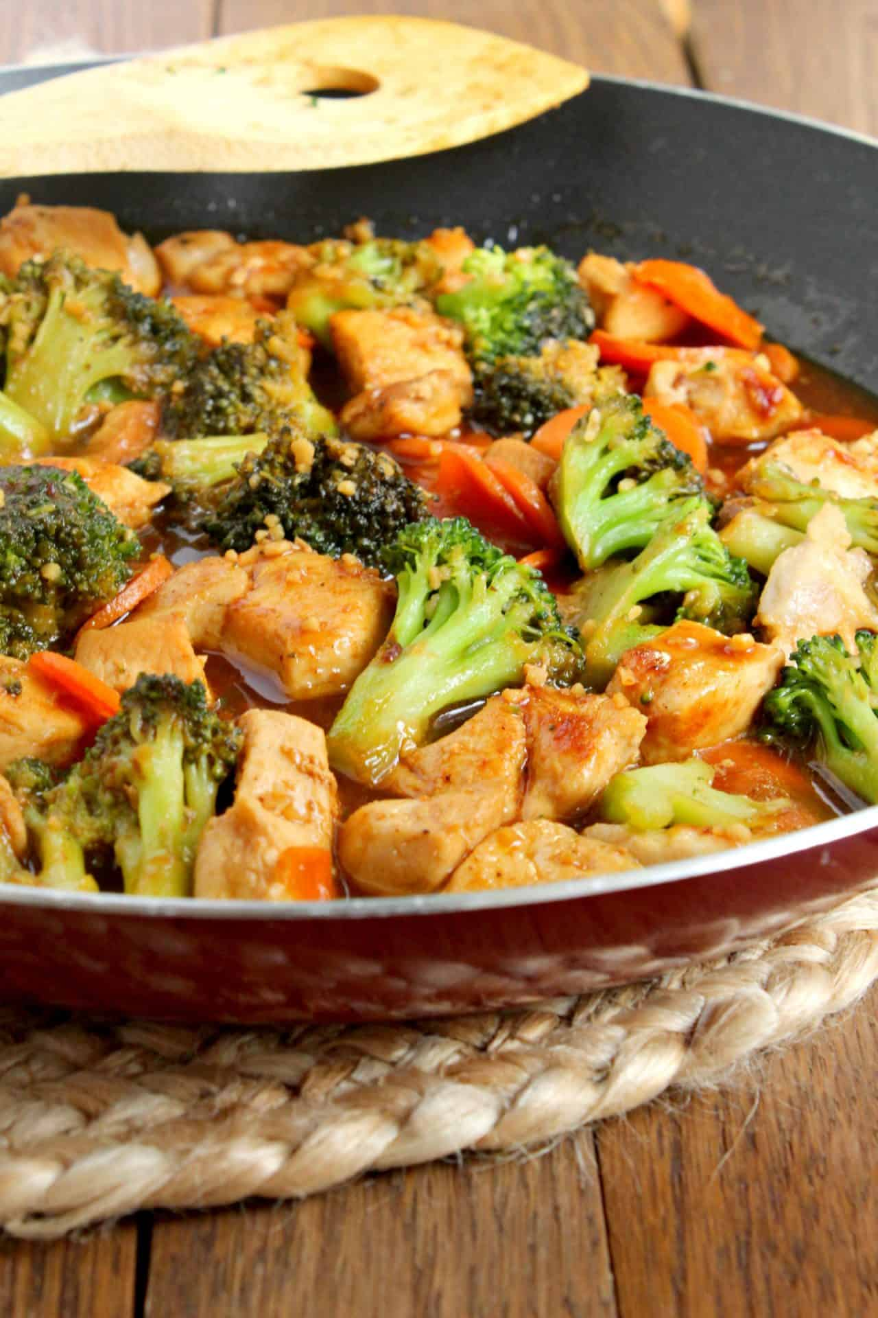 honey garlic stir fry in a red pan