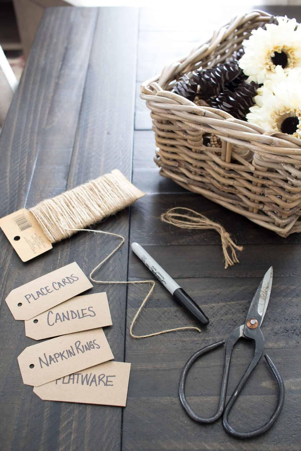 kraft paper labels, string, scissors and marker for label making