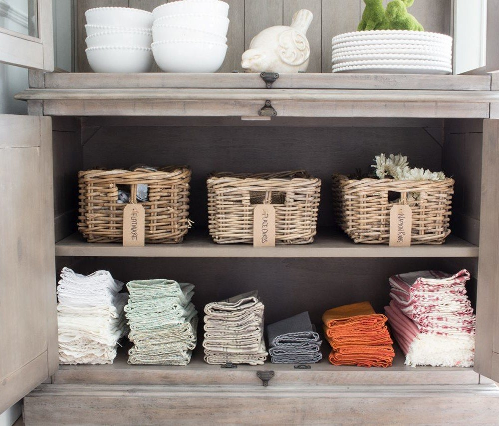 Napkin and other dining room storage organized in a hutch