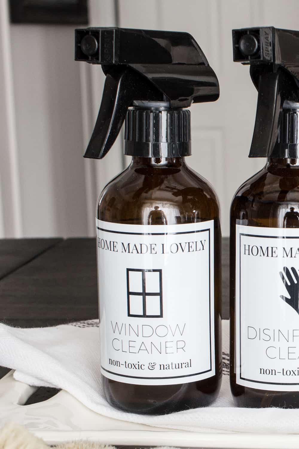 amber glass spray bottles with attached printed cleaner labels