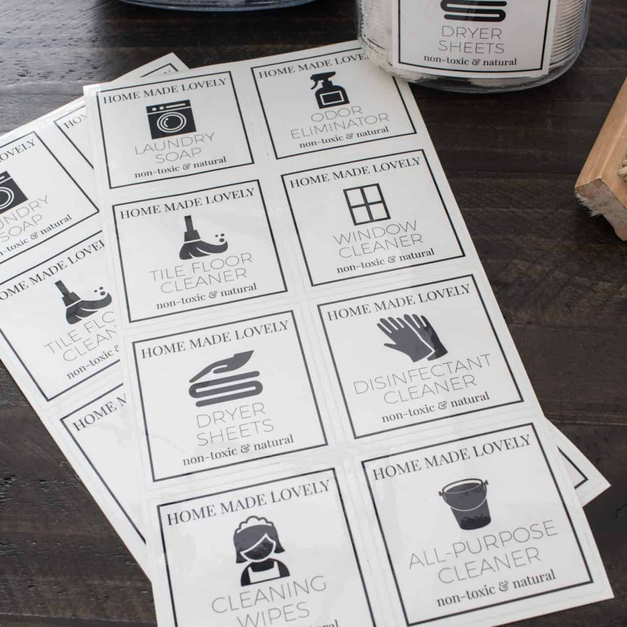 printed cleaner labels laying on table ready to be cut out