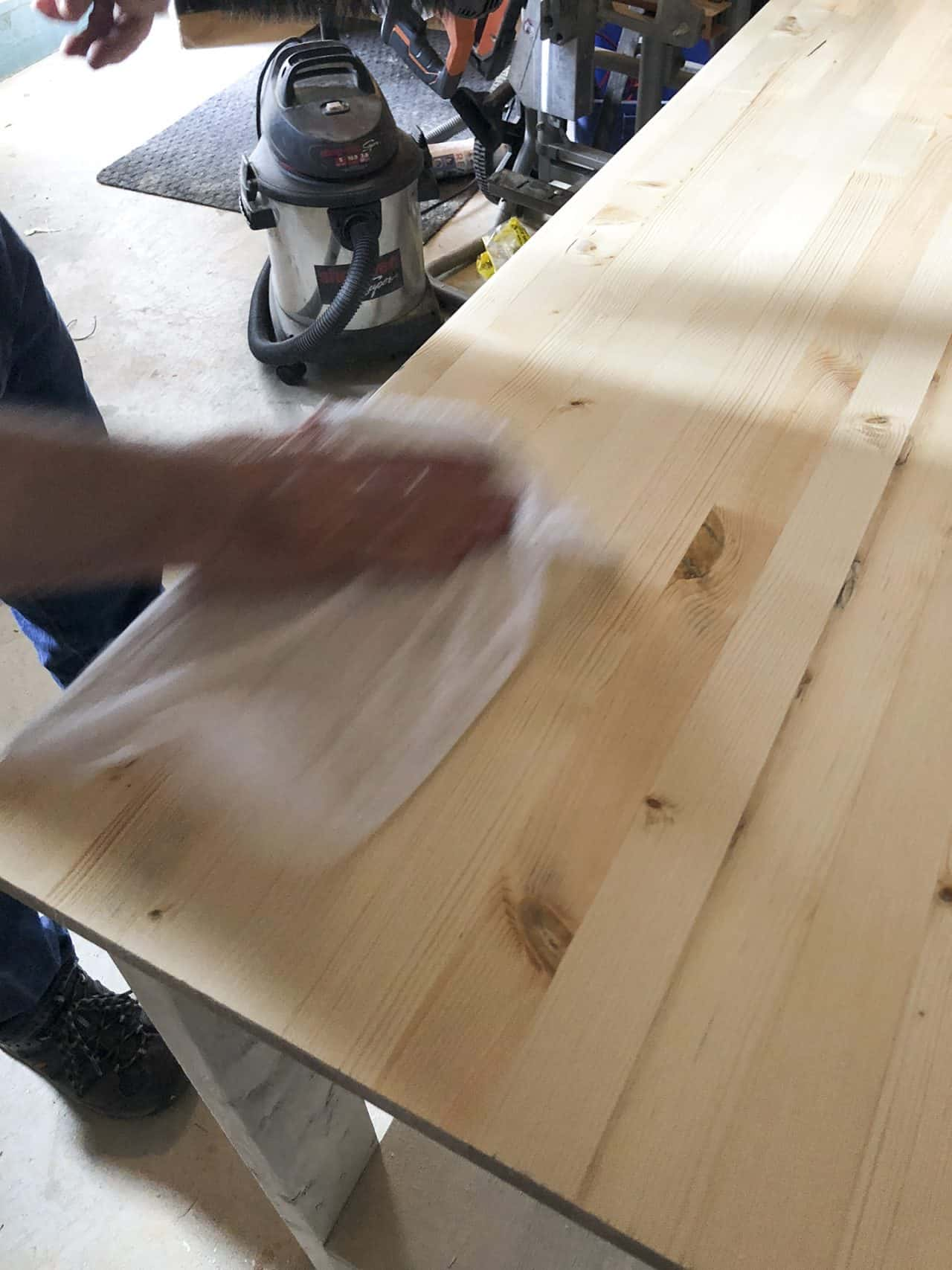 wetting wood with a lint free cloth