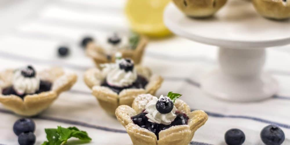 optionally add garnish to each tart