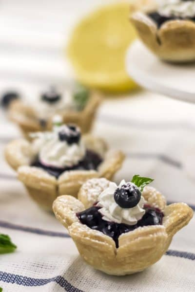 optionally add garnish to each tart