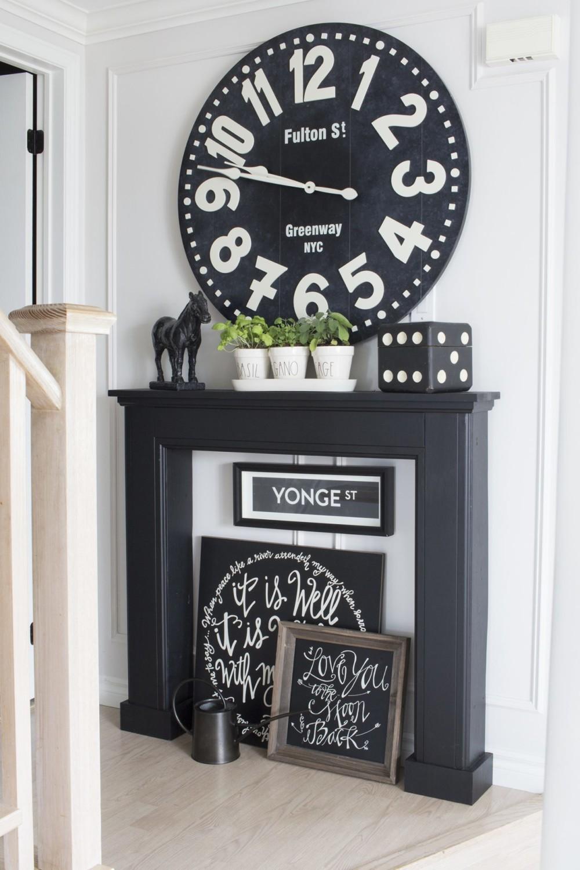 black mantel huge clock signs plants