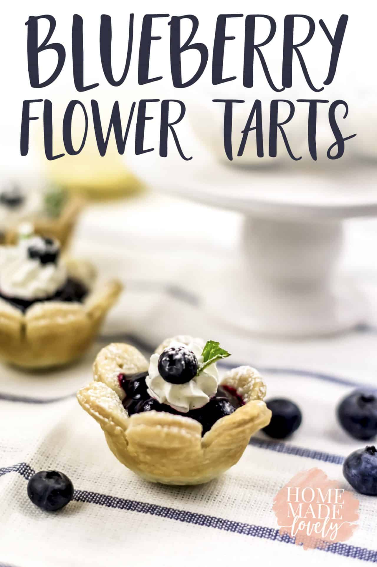 Make these cute little blueberry flower tarts with the kids or for a summer picnic! #summerrecipe #blueberrytart #recipe