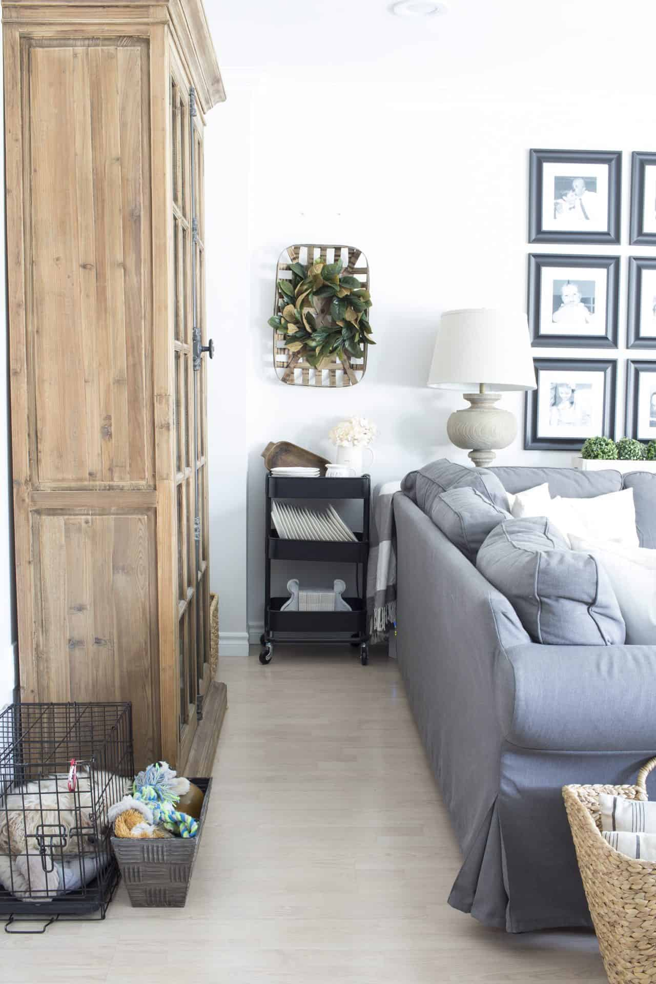 farmhouse decor behind couch dog crate