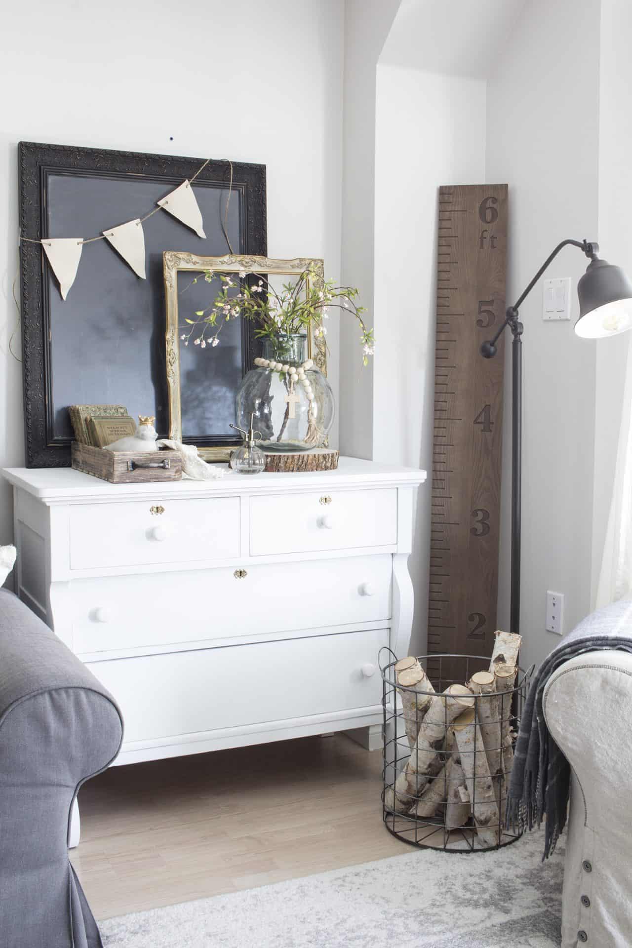 farmhouse decor on dresser in living room