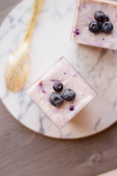 top each individual cheesecake with blueberries before serving