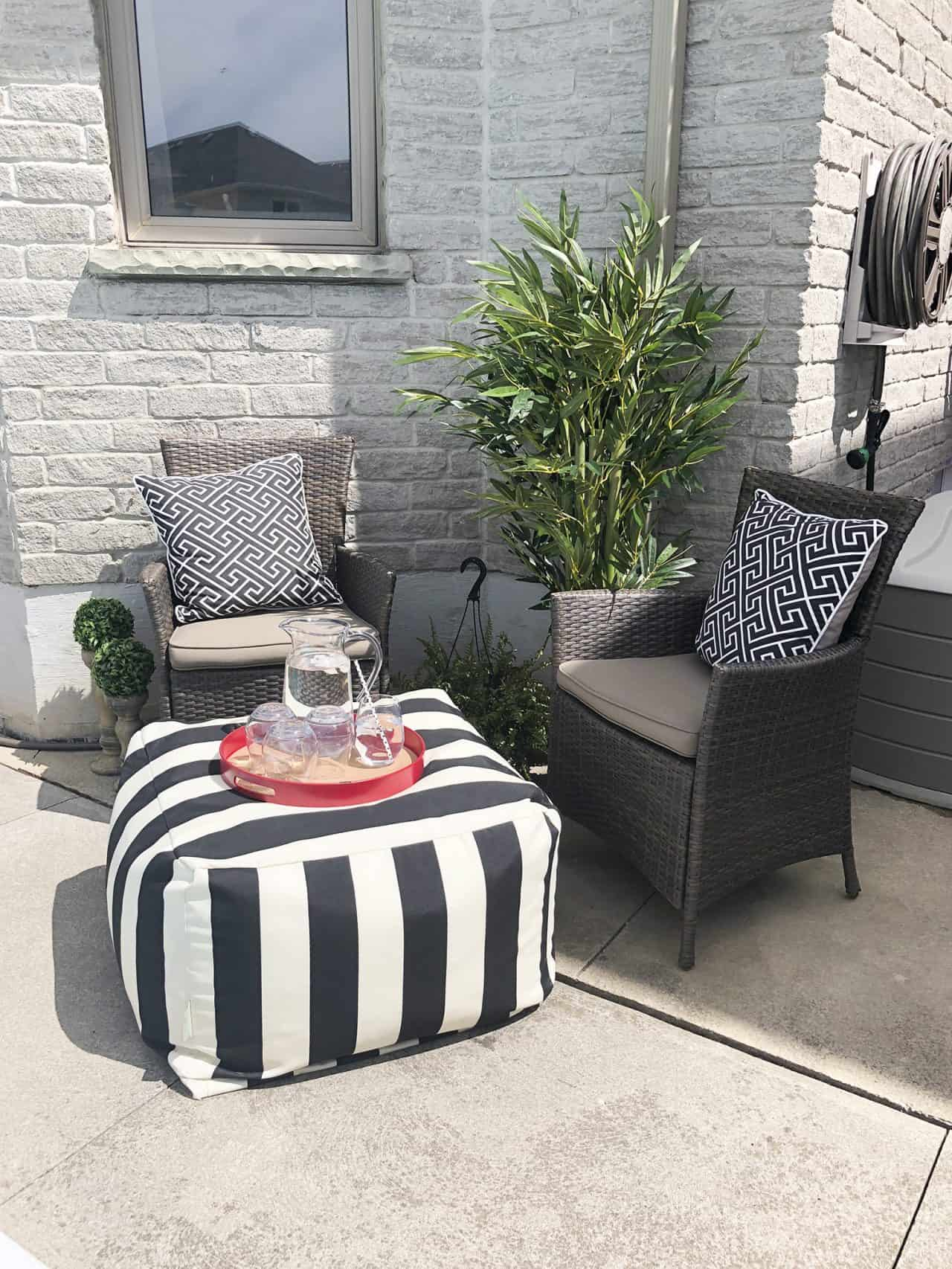 black and white striped outdoor ottoman