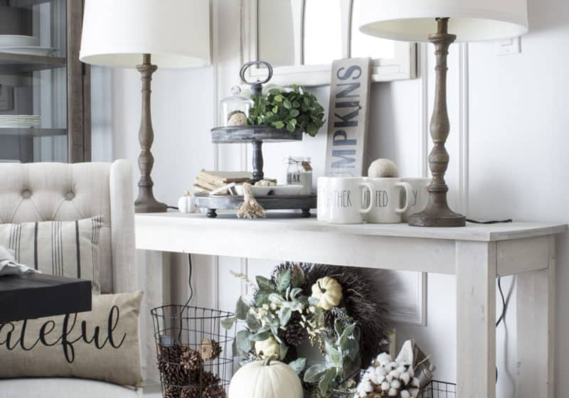 fall farmhouse decor on dining room console table