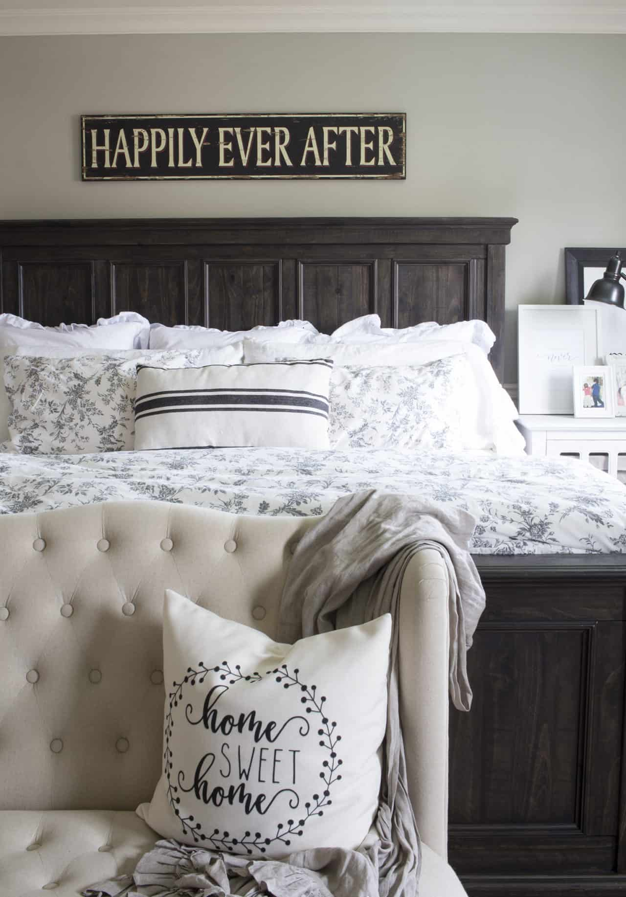 dark wood king size bed with white bedding and taupe walls in a north facing room to illustrate the effect of northen exposure