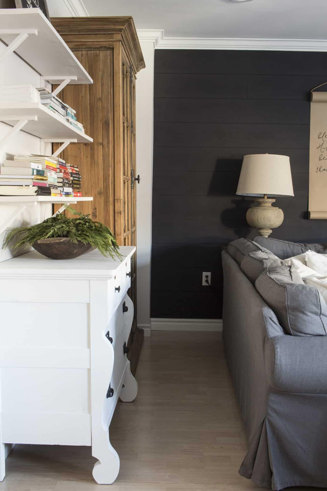 white dresser pine cabinet black shiplap wall