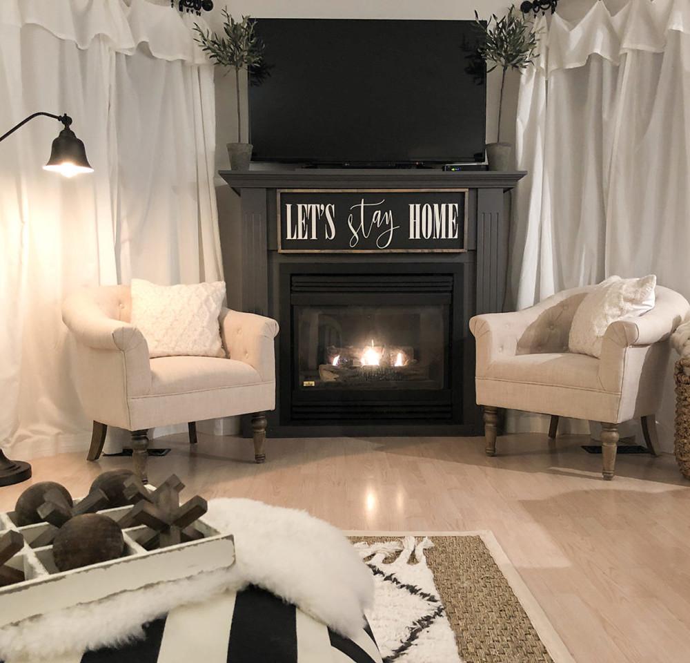 Lordana Barrel Chairs by fireplace night
