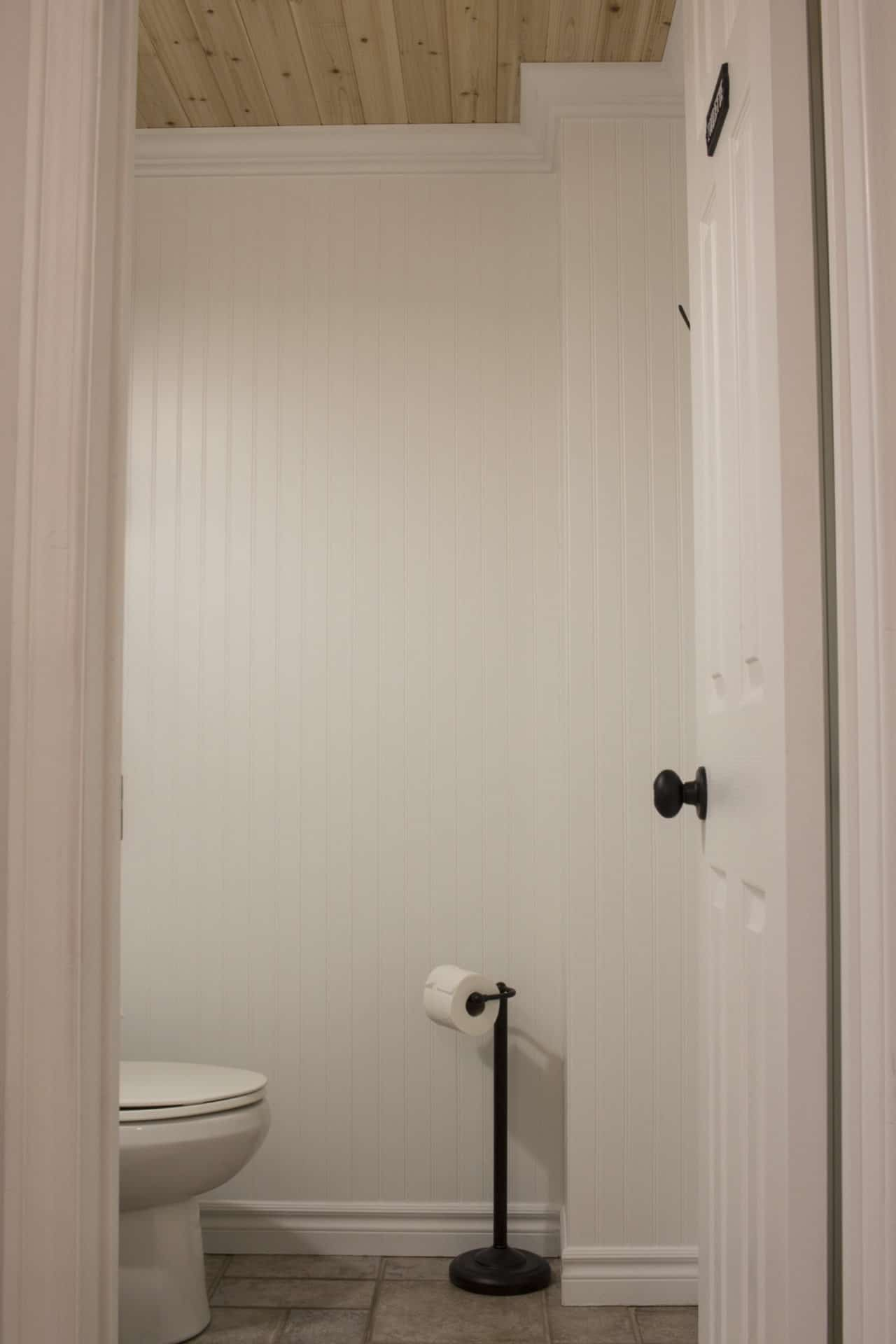 half bath beadboard wall and cedar ceiling