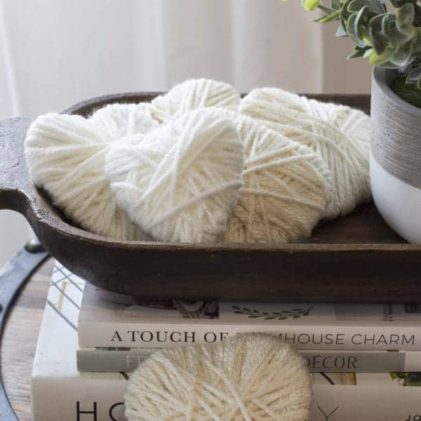 yarn wrapped hearts in dough bowl