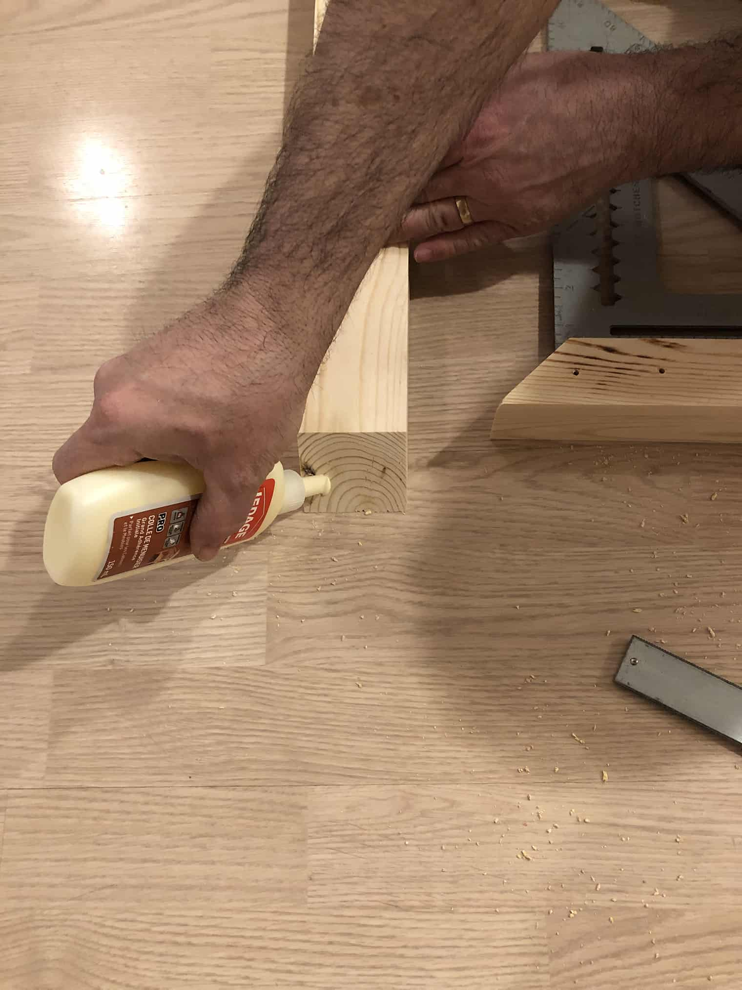 man gluing wood