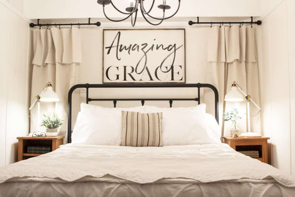 Amazing Grace framed over iron bed