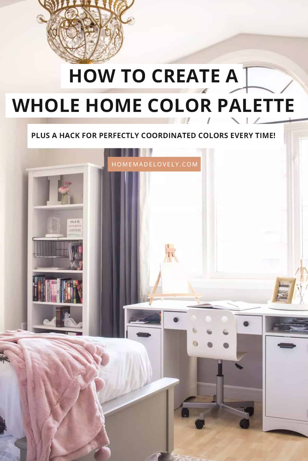 Bright bedroom with a desk under a window with words on image to show how to create a whole home color scheme
