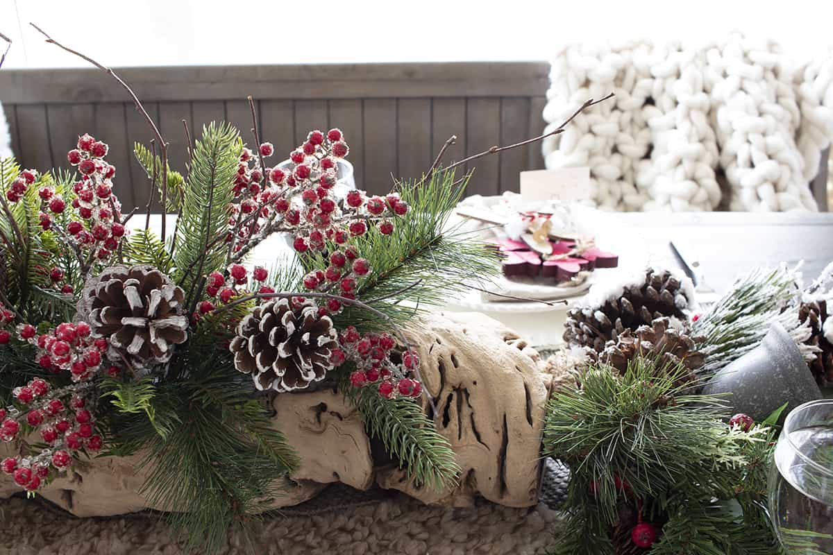 Christmas log centerpiece with frosty berries
