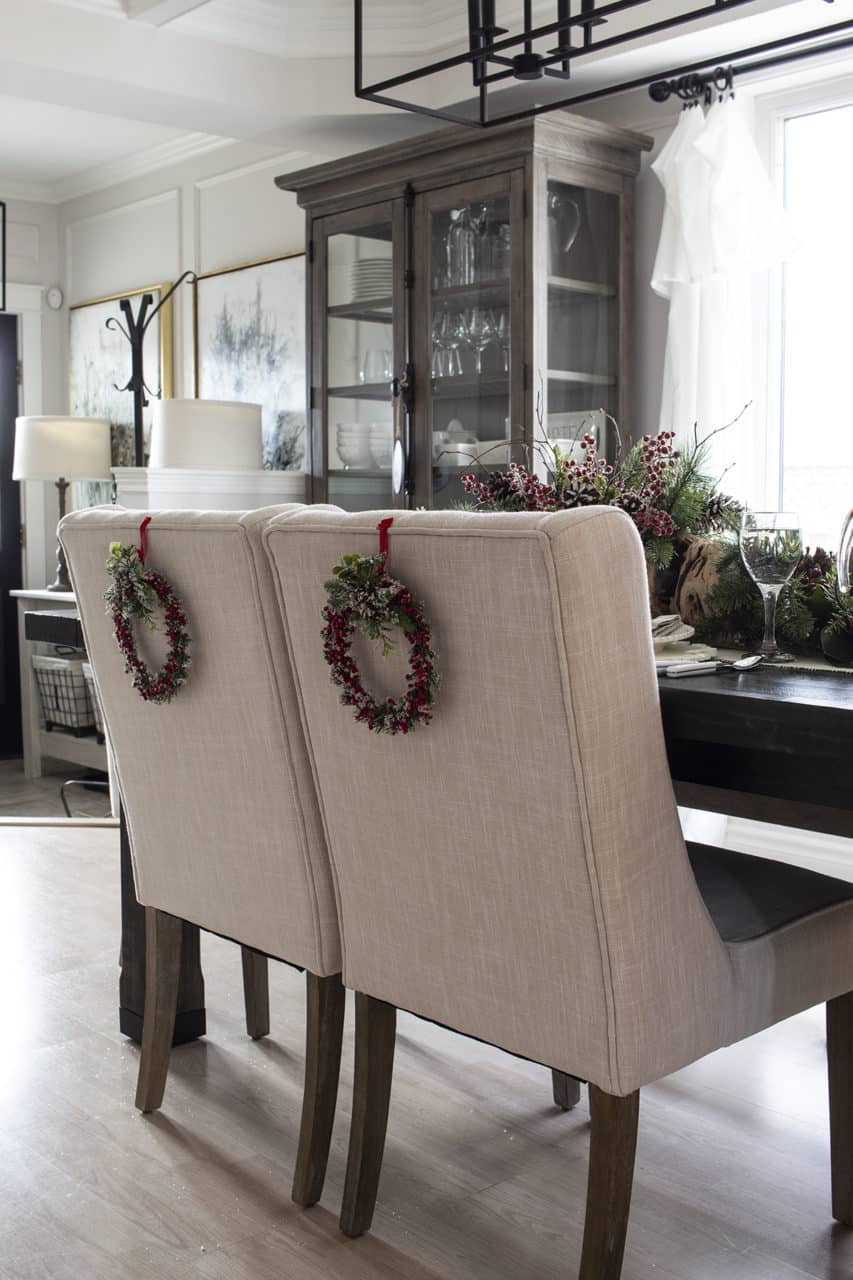 holiday wreaths on back of dining chairs