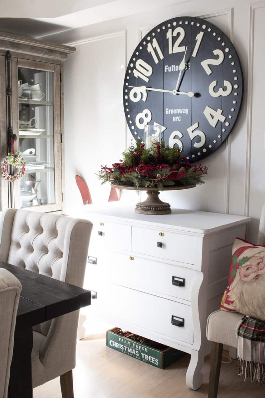 Dining room side table with oversized clock above