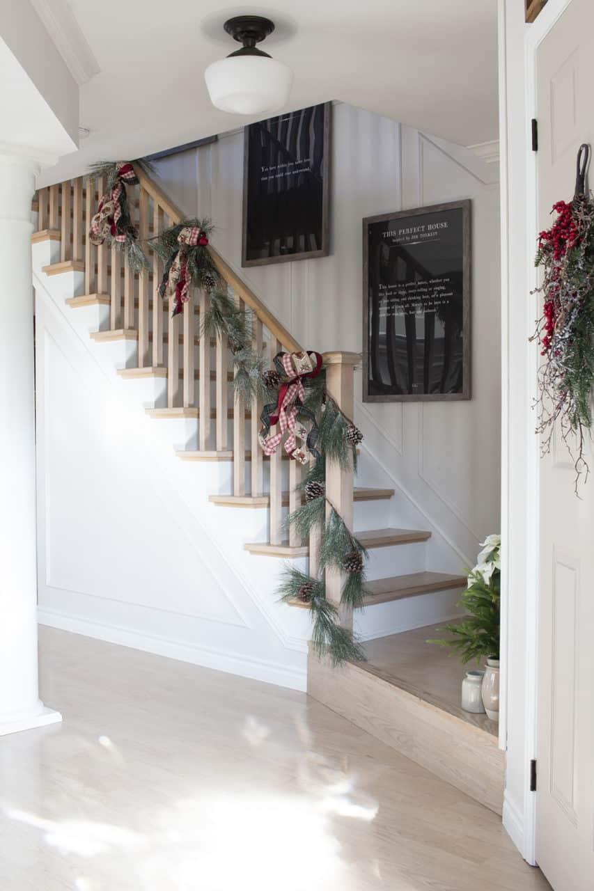 Neutral Stairwell with Christmas Garland on Banister