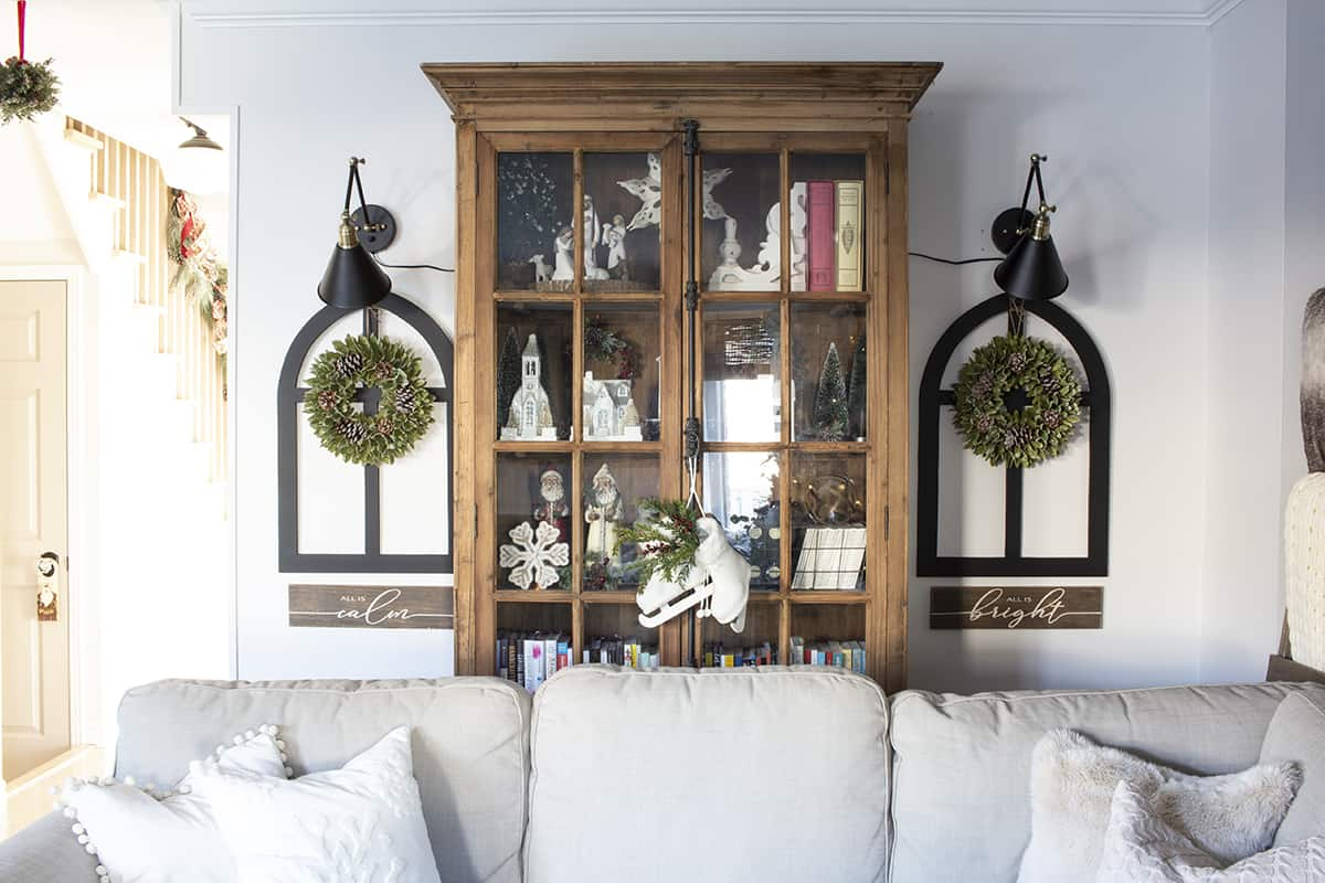 pine glass door bookcase with Christmas decor inside