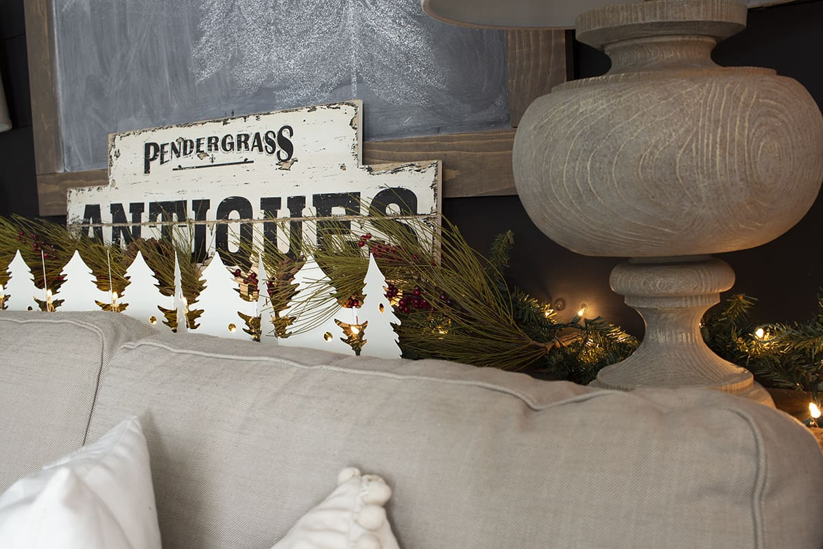 antiques sign greenery white metal trees twinkle lights sofa table