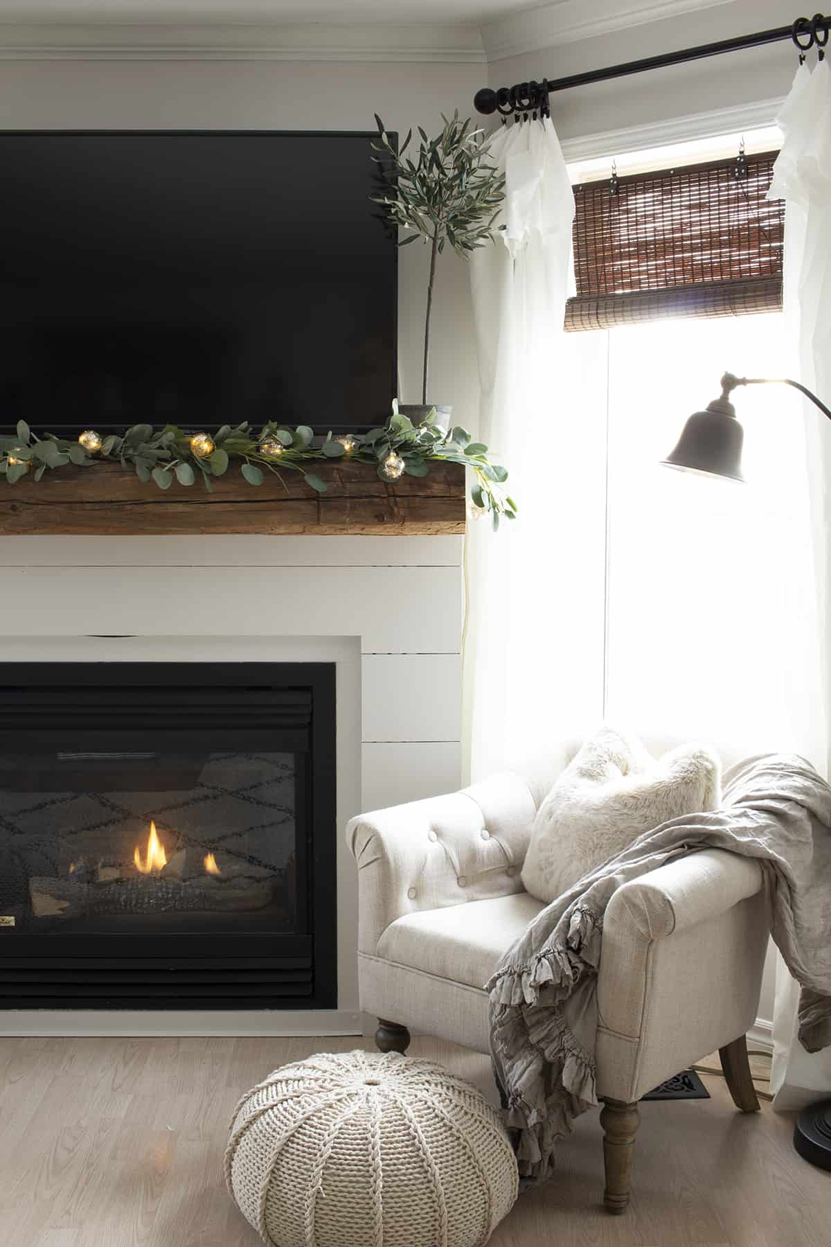 cozy shiplap fireplace tufted chair