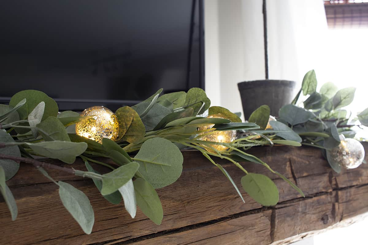 faux eucalyptus garland on barn beam mantel