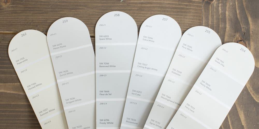 white paint fan deck on table