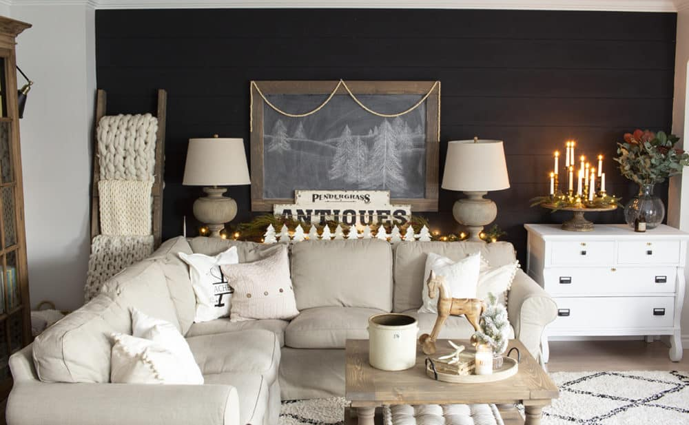 winter living room with black shiplap wall and neutral decor