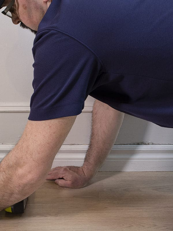 How to Install Baseboards, Plus How to Caulk Them Easily