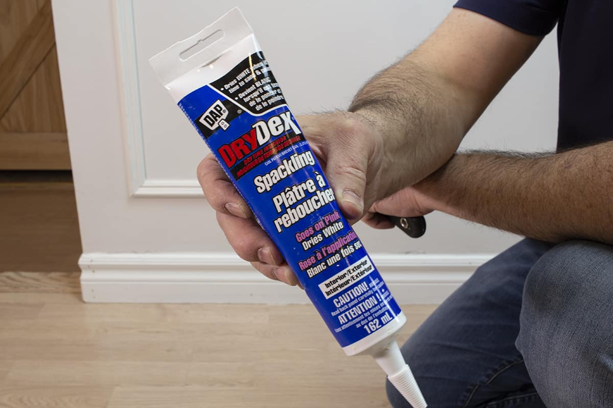 man showing drydex spackling compound