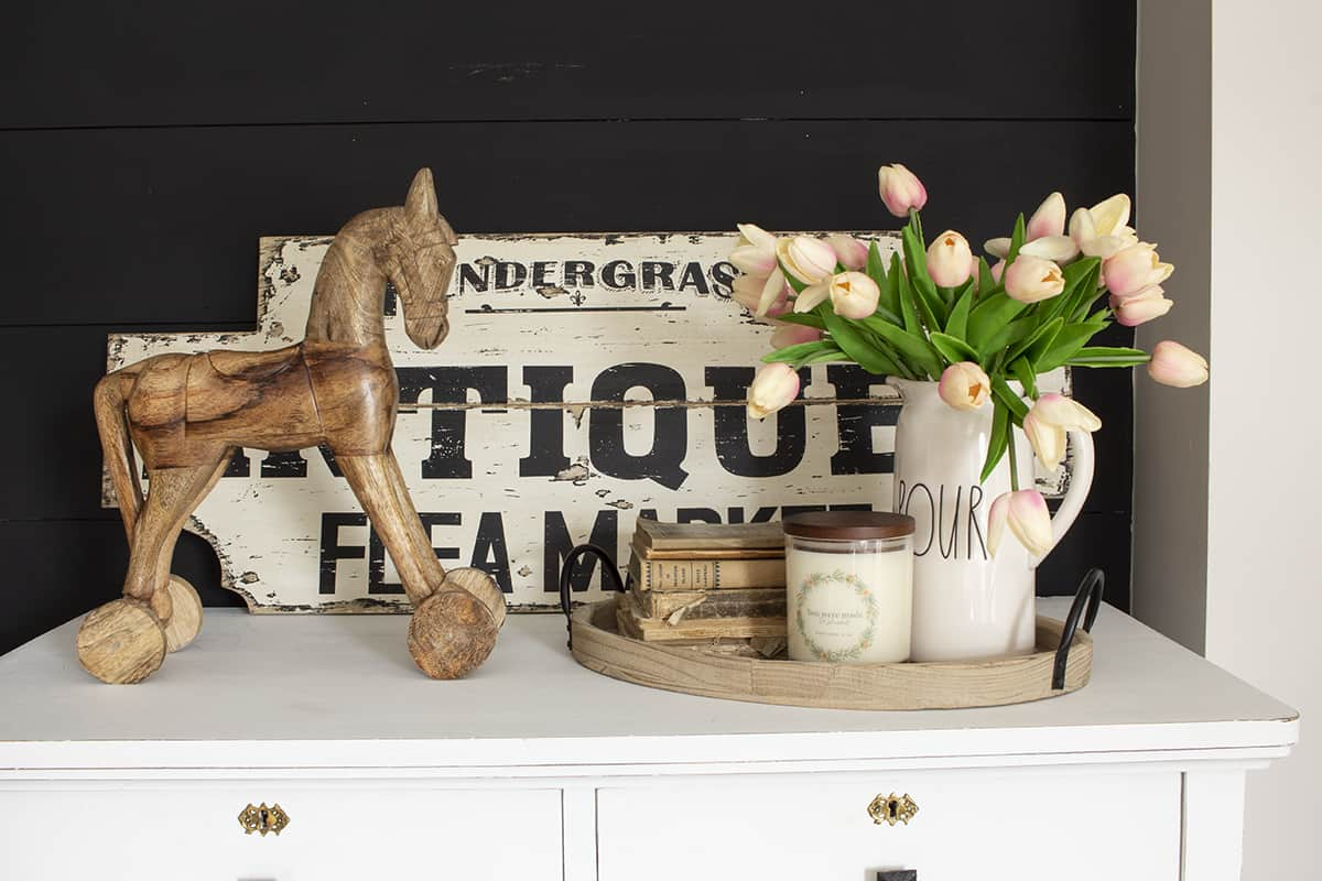 antique sign wooden horse and tulips on dresser