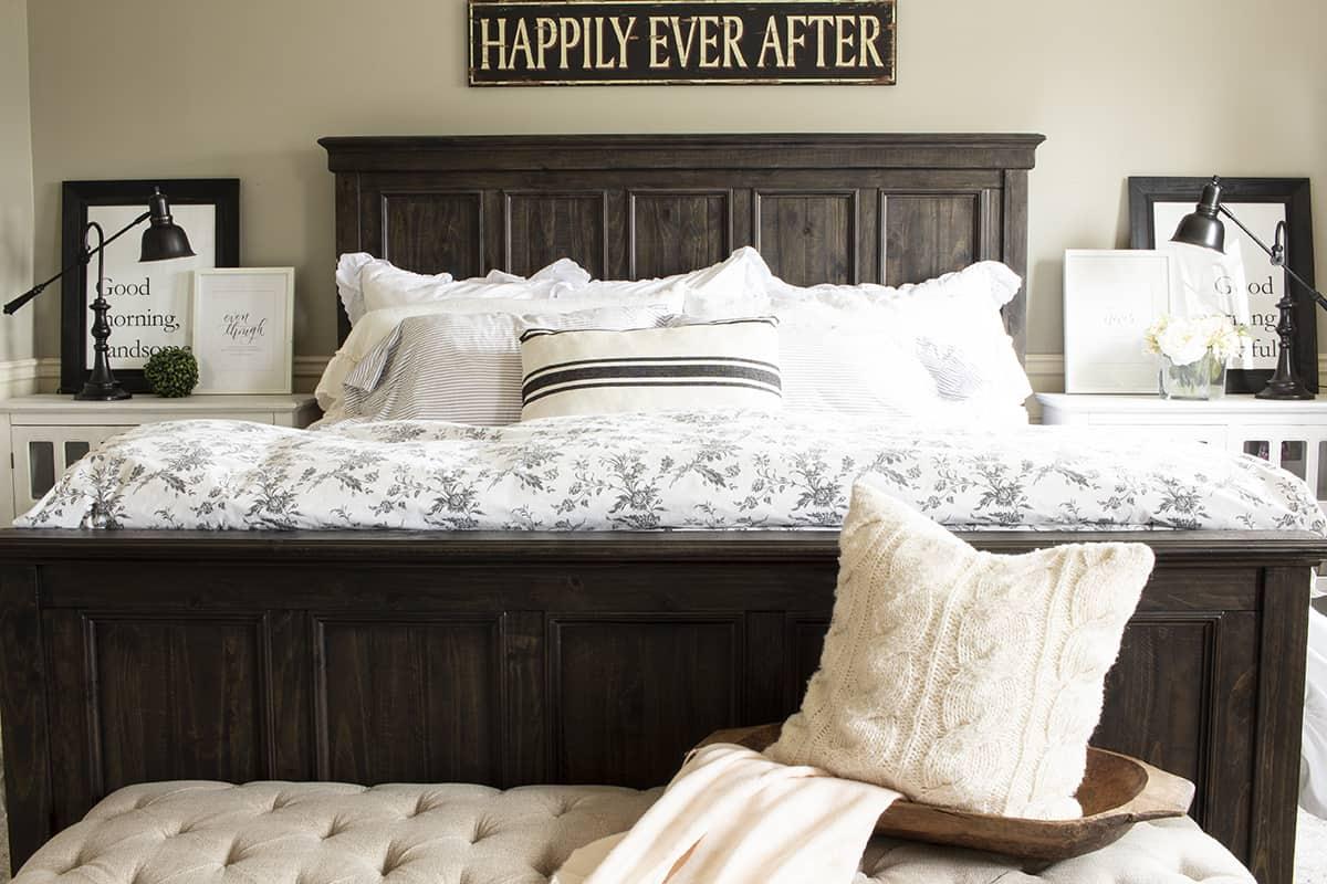farmhouse bedroom dark bed frame, white blankets