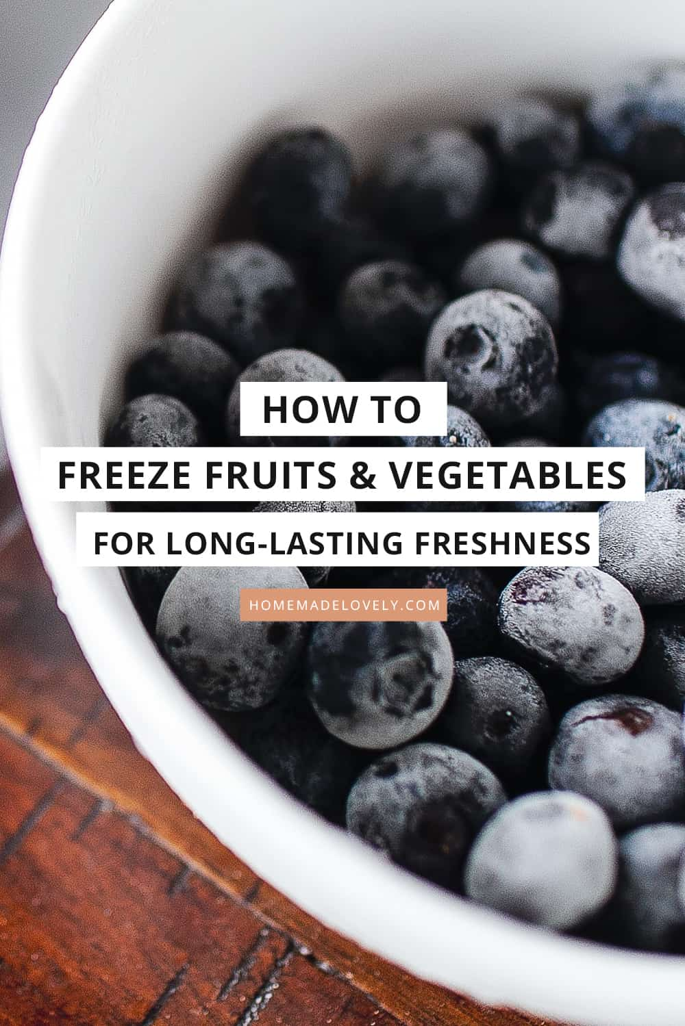 frozen blueberries in a white bowl with text overlay that says how to freeze fruits and vegetables for long-lasting freshness