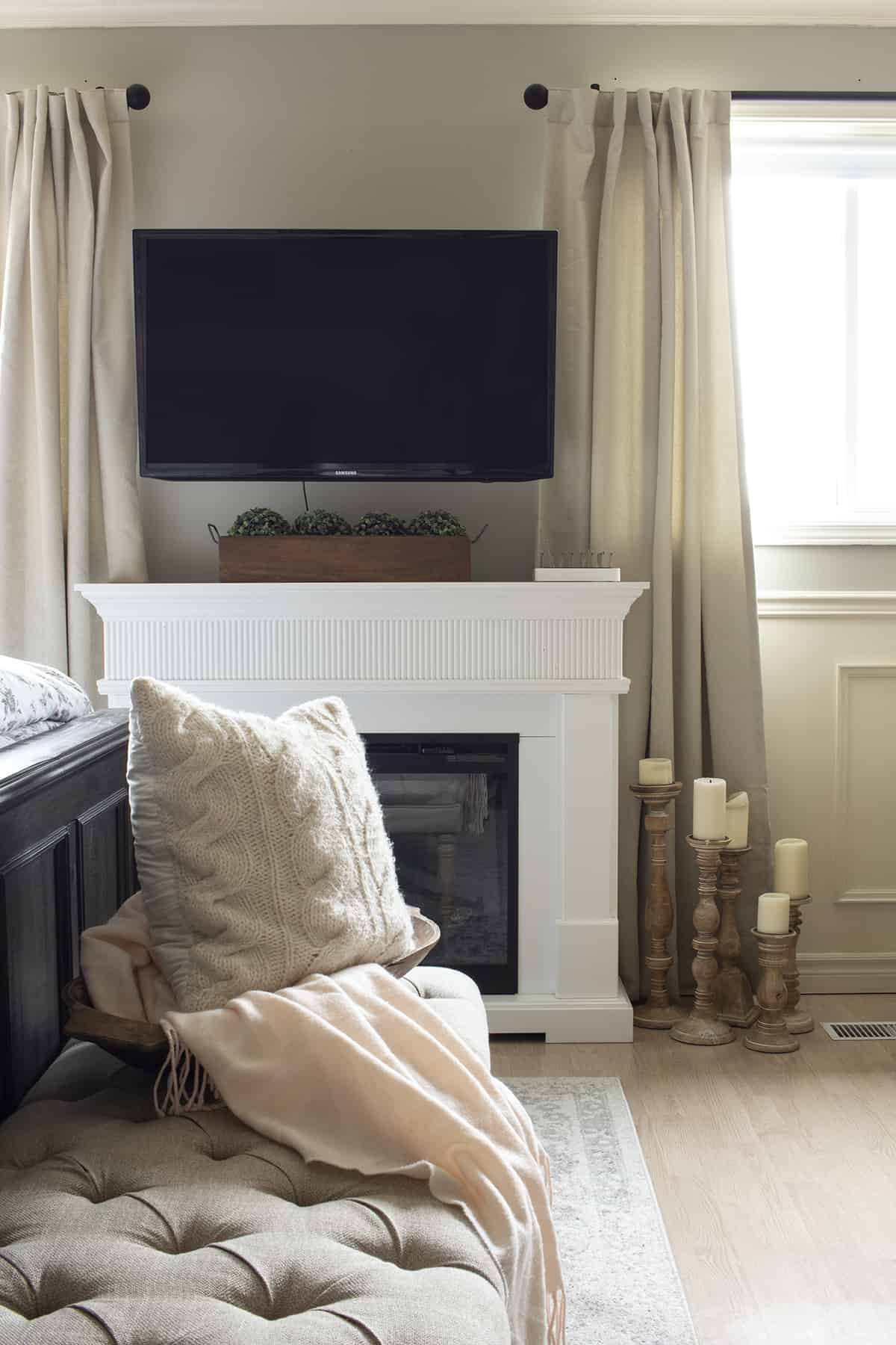master bedroom electric fireplace with tv above