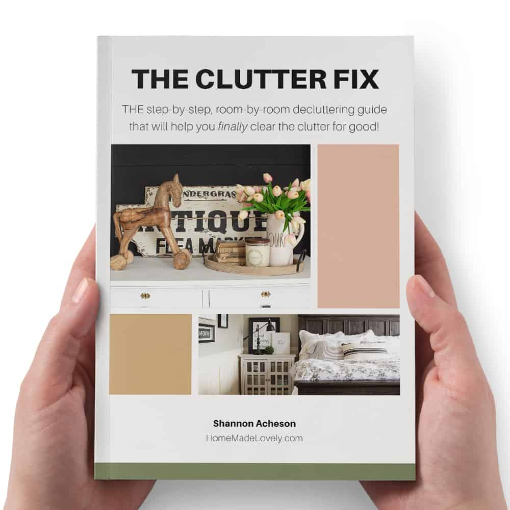 the clutter fix book in hands