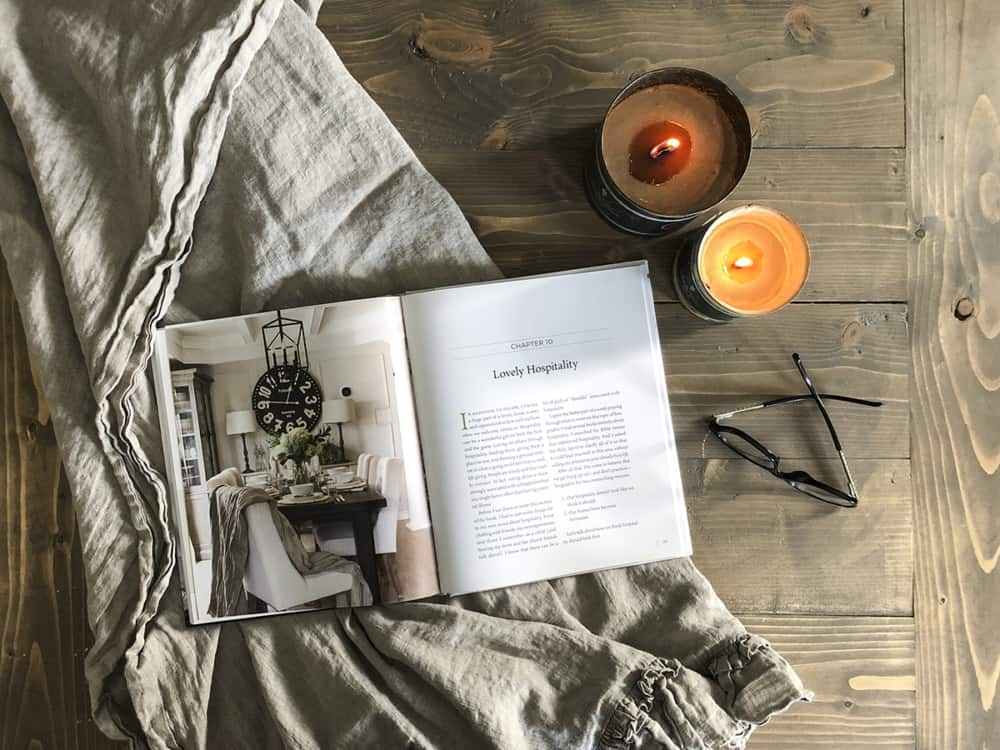 HML Book Lovely Hospitality chapter with candles and linen blanket