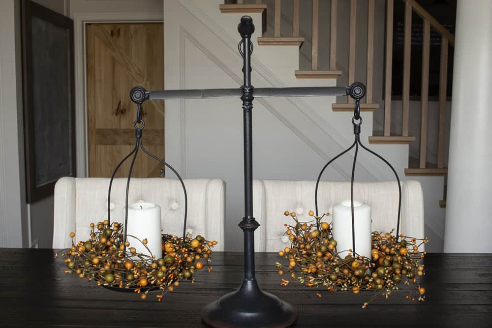 farmhouse scale with orange pip berries and candles