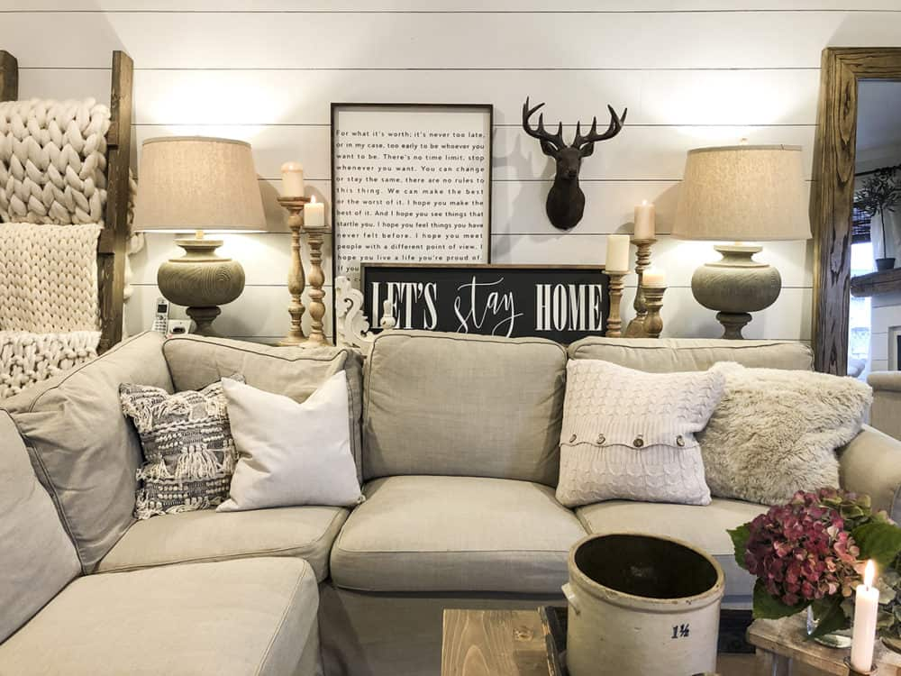 beige ektorp sectional with white shiplap wall