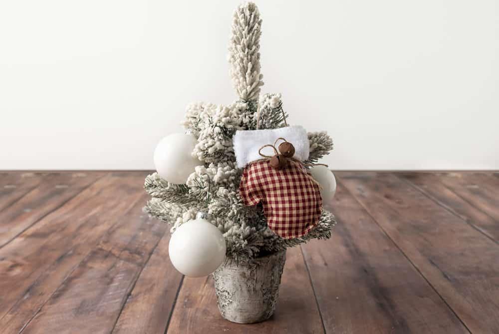 farmhouse style mitten ornament on mini tree