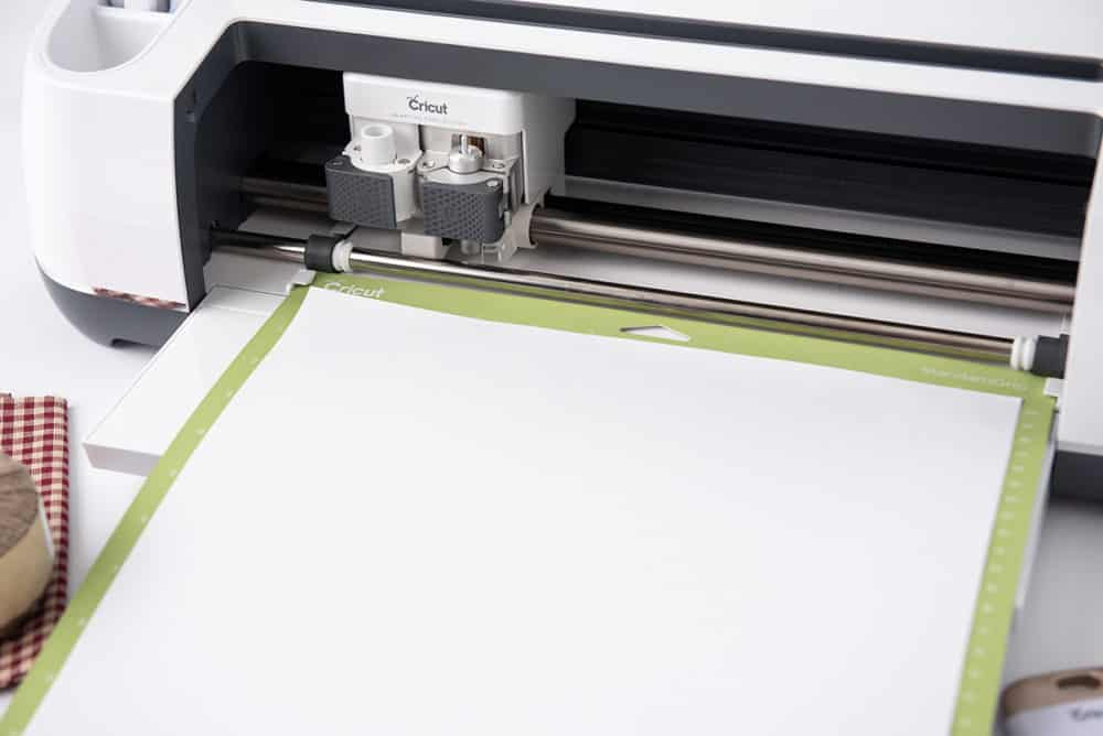 loading the cutting mat into Cricut